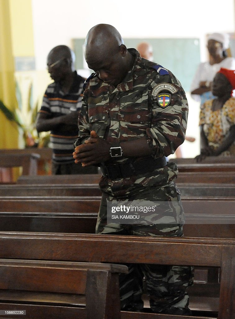 A Central African Republic gendarme prays on January 1, 2013 at Bangui's cathedral during a mass for peace led by Bangui's bishop. Rebels in the Central African Republic vowed on December 31, 2012 to take the last key town before the capital and renewed their call for the president to stand down, voicing scepticism over his pledge to make concessions.
