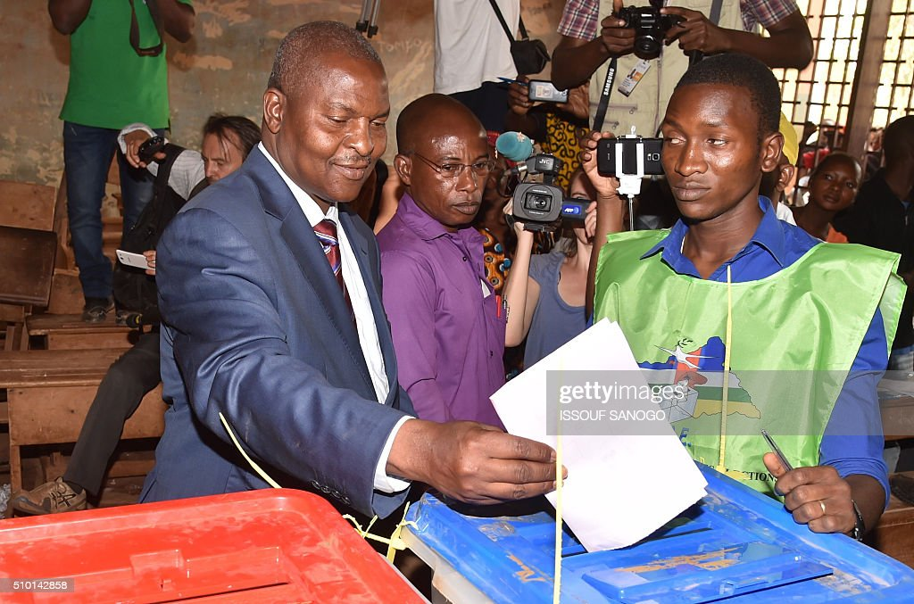 Central African Republic second round presidential candidate Faustin Archange Touadera casts his ballot for delayed legislative elections and a presidential run-off, at a polling station in Bangui, on February 14, 2016. The Central African Republic holds delayed presidential and parliamentary polls on February 14, with voters desperate to usher in peace after the country's worst sectarian violence since independence in 1960. / AFP / ISSOUF SANOGO