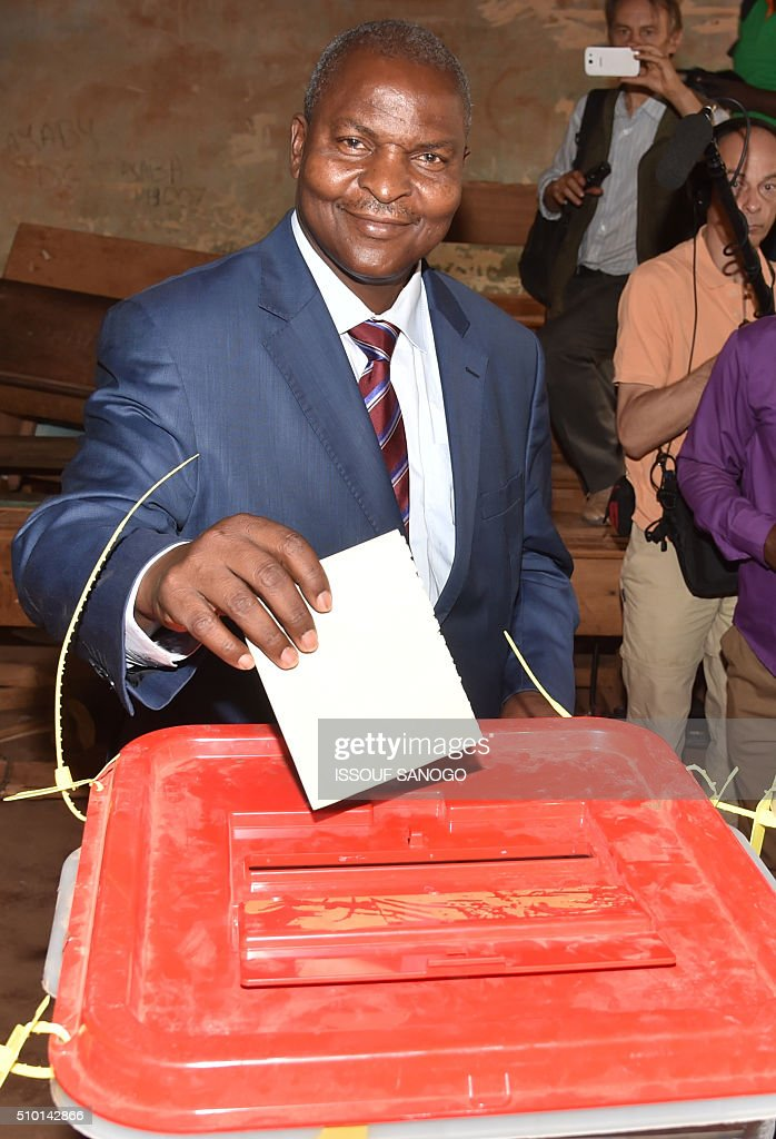 Central African Republic second round presidential candidate Faustin Archange Touadera smiles as he casts his ballot for delayed legislative elections and a presidential run-off, at a polling station in Bangui, on February 14, 2016. The Central African Republic holds delayed presidential and parliamentary polls on February 14, with voters desperate to usher in peace after the country's worst sectarian violence since independence in 1960. / AFP / ISSOUF SANOGO