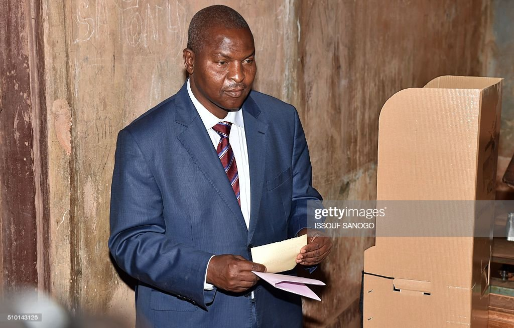 Central African Republic second round presidential candidate Faustin Archange Touadera prepares his ballot before voting for delayed legislative elections and a presidential run-off, at a polling station in Bangui, on February 14, 2016. The Central African Republic holds delayed presidential and parliamentary polls on February 14, with voters desperate to usher in peace after the country's worst sectarian violence since independence in 1960. / AFP / ISSOUF SANOGO