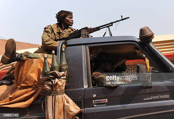 Central African Republic soldiers patrol on a pick up truck in a street of Bangui on December 31 2012 Nightfall in Bangui's normally bustling streets...
