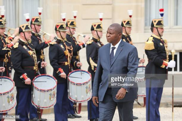 Central African Republic's president FaustinArchange Touadera reviews Republican Guards upon his arrival for a meeting with his French counterpart at...
