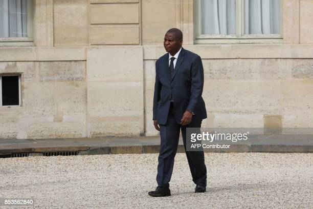 Central African Republic's president FaustinArchange Touadera walks across the courtyard of the Elysee palace upon his arrival for a meeting with his...