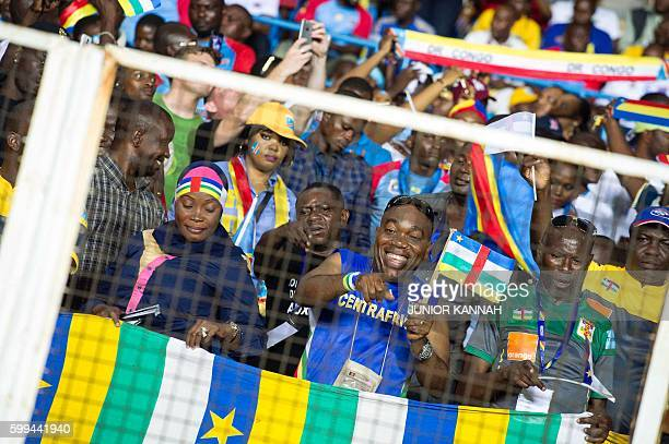 Central African Republic's supporters cheer their team during the 2017 African Cup of Nations qualifying football match between Democratic Republic...