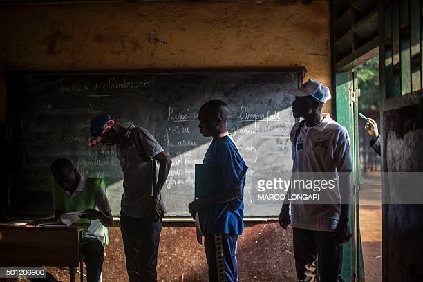 TOPSHOT Central African voters queue at a polling station in Bangui on December 13 2015 to cast their ballot for the Constitutional Referendum At...