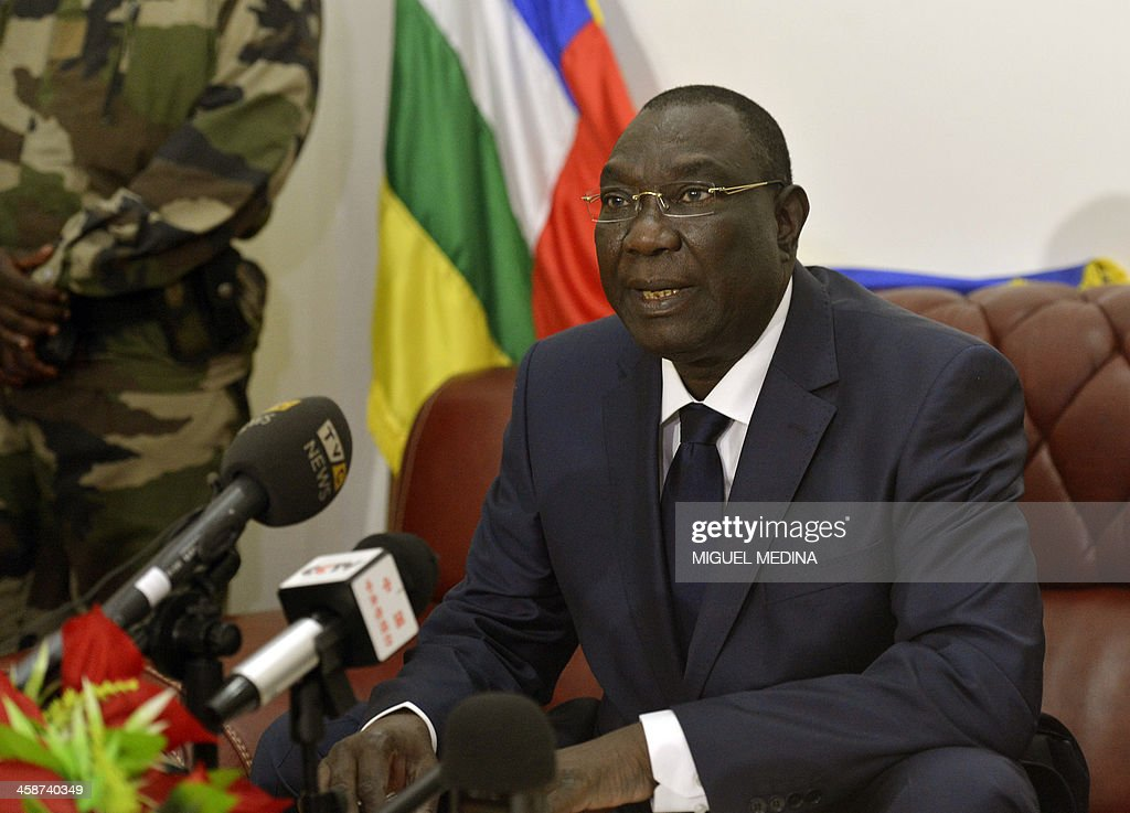 Central Africa's interim leader <a gi-track='captionPersonalityLinkClicked' href=/galleries/search?phrase=Michel+Djotodia&family=editorial&specificpeople=10107290 ng-click='$event.stopPropagation()'>Michel Djotodia</a> gives a statement to the press at his Bangui residence on December 21, 2013. More than 30 people including a Chadian peacekeeper have been killed in a fresh outbreak of brutal sectarian violence in the Central African Republic capital, sources said Friday. The Central African Red Cross said it had retrieved 29 bodies from the streets of Bangui after heavy fighting broke out overnight, continuing into early Friday. The Central African Republic (CAR) spiralled into chaos after a March coup in which the mainly Muslim Seleka rebel group overthrew president Francois Bozize. Rebel leader <a gi-track='captionPersonalityLinkClicked' href=/galleries/search?phrase=Michel+Djotodia&family=editorial&specificpeople=10107290 ng-click='$event.stopPropagation()'>Michel Djotodia</a> was installed as the first Muslim leader of the majority Christian nation and disbanded the Seleka, but many rebels went rogue, spreading terror. AFP PHOTO/MIGUEL MEDINA
