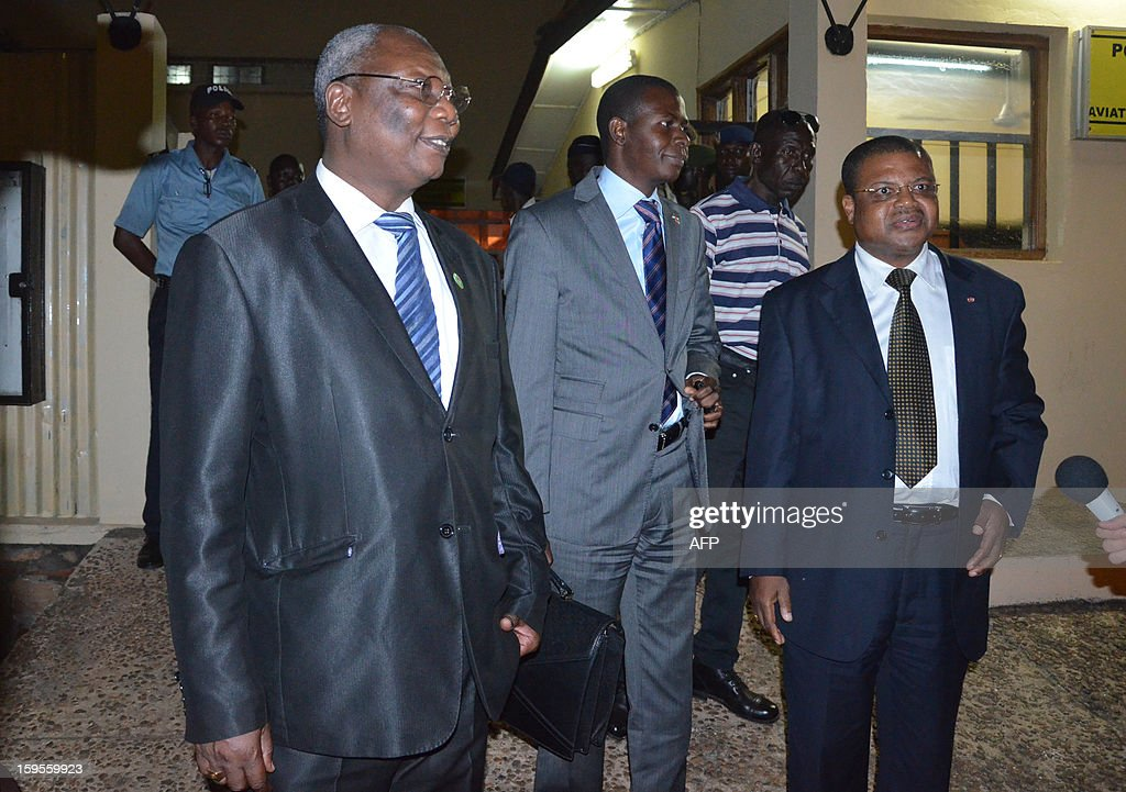 Central Africa's leading opposition figure Martin Ziguele (L), Centrafrican lawyers Crepin Mboli-Goumba (C) and Nicolas Tiangaye (R) arrive in Bangui on January 15 2013. The Seleka rebel alliance in the Central African Republic said it backed opposition figure Nicolas Tiangaye to become prime minister in a move that advances a peace deal reached last week. 'We have just confirmed Mr Tiangaye as prime minister. He is the future prime minister, there is no more objection,' Seleka rebel coalition chief Michel Djotodia told AFP in Brazzaville after talks with the Republic of Congo's President Denis Sassou Nguesso, who heads a follow-up committee monitoring the accord.