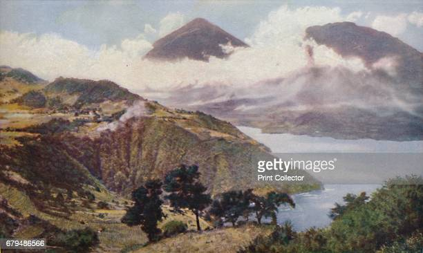Central America Ringed in by peaks of the Guatemalan Cordillera Lake Atitlan fills a crater 1000 feet deep near the volcanic cones of San Pedro and...