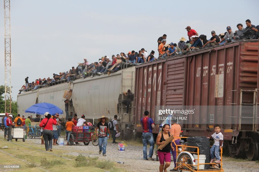 Central American immigrant get on the socalled La Bestia cargo train in an attempt to reach the MexicoUS border in Arriaga Chiapas state Mexico on...