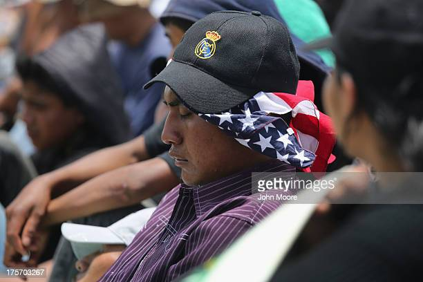 Central American immigrants fall asleep on top of a freight train on August 6 2013 near Juchitan Mexico Thousands of Central American migrants ride...