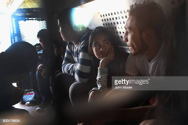 Central American immigrants wait to be transported after turning themselves in to US Border Patrol agents on December 8 2015 near Rio Grande City...