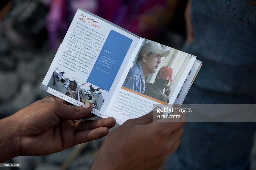 A Central American migrant reads a brochure in Huehuetoca, Mexico state, on January 28, 2013. A group of university students, religious people and humanitarian movements inaugurated a dining room for migrants from differents countries travelling through Mexico on their way to the US border. AFP PHOTO/Yuri CORTEZ