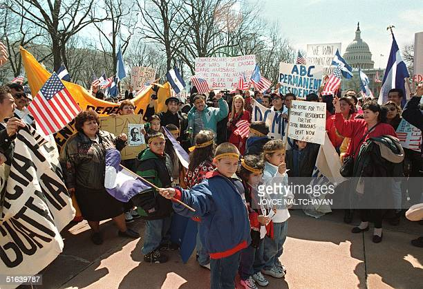 Central American refugees from El Salvador Guatemala and other countries hold a rally in front of the US Capitol building 25 March in Washington DC...