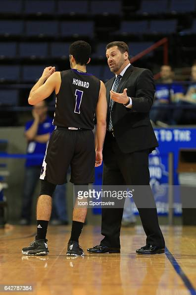 Central Arkansas Bears head coach Russ Pennell talks to Central Arkansas Bears guard Jordan Howard during a game between Central Arkansas and New...