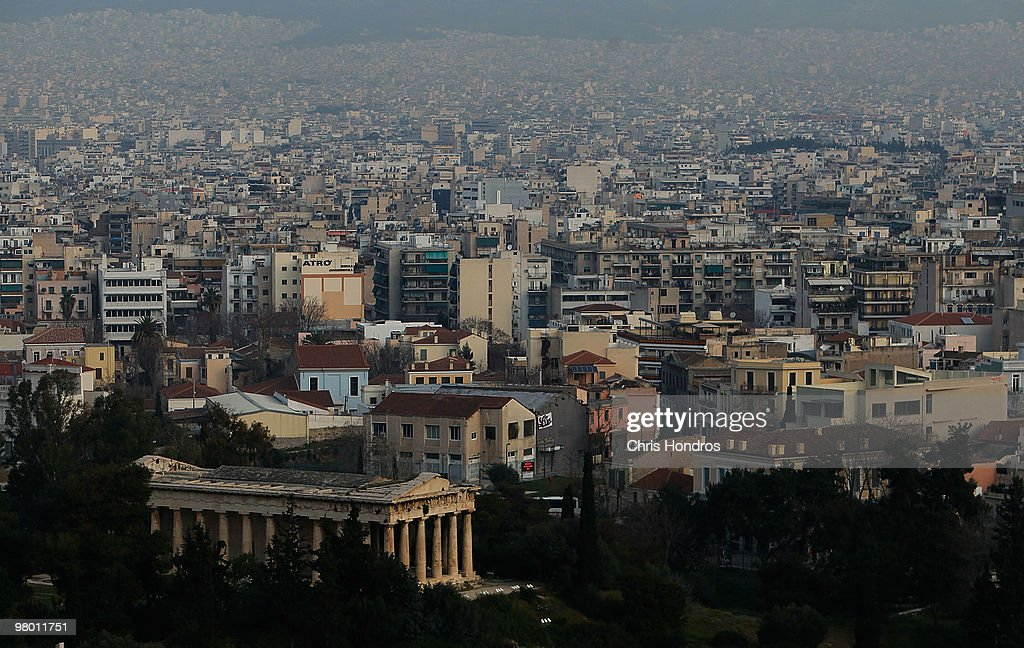 Central Athens, featuring ancient ruins and modern housing, is seen in the early-morning hours on March 24, 2010 in Athens, Greece. Higher prosperity made its way to once-unfashionable Greece in the last 15 years since the small country began reforming its economy to join the euro zone. But some argue that Greece overextended itself, and fellow European nations negotiated March 24 over what role the International Monetary Fund could play in European Union efforts to alleviate Greece's debt crisis. Greece's debt and economic woes have prompted forced austerity measures as a condition of staying in the European Union, and EU-heavyweight Germany has opposed a bailout of the fragile, debt-ridden Greek economy.