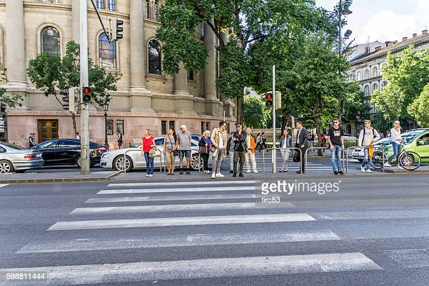 Central Budapest street people waiting to cross road