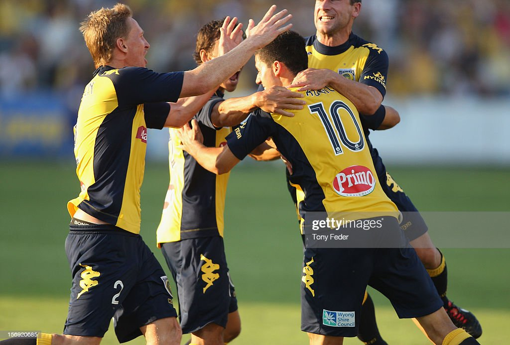 Central Coast Mariners players celebrate a goal during the round eight A-League match between the Central Coast Mariners and the Brisbane Roar at at Bluetongue Stadium on November 25, 2012 in Gosford, Australia.