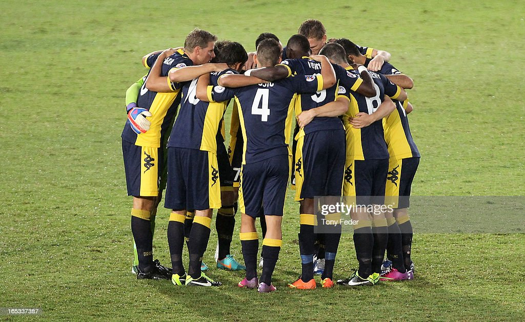 Central Coast Mariners players huddle pre game during the AFC Asian Champions League match between the Central Coast Mariners and Guizhou at Bluetongue Stadium on April 3, 2013 in Gosford, Australia.