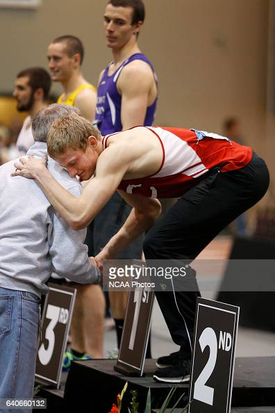 Central College's Eric Larson hugs his coach after receiving his 1st Place trophy for winning the Men's Heptathlon at the Division III Men's and...