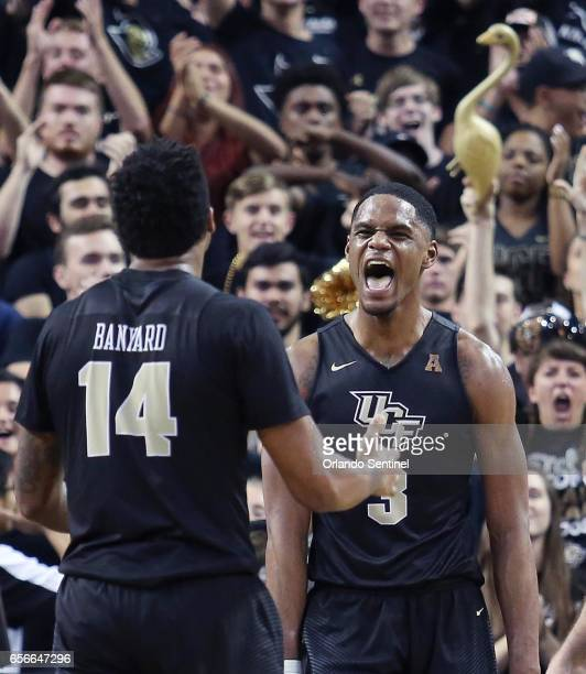Central Florida's AJ Davis celebrates with teammte Nick Banyard during a 6858 win against Illinois during an NIT Tournament quarterfinal at CFE Arena...