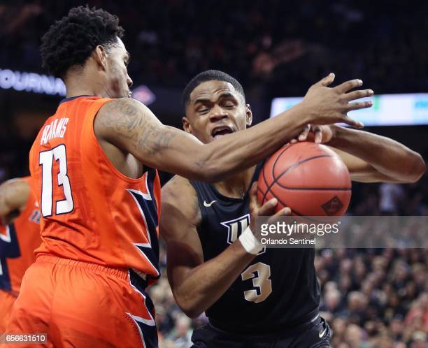 Central Florida's AJ Davis is fouled by Illinois guard Tracy Abrams during an NIT Tournament quarterfinal at CFE Arena in Orlando Fla on Wednesday...