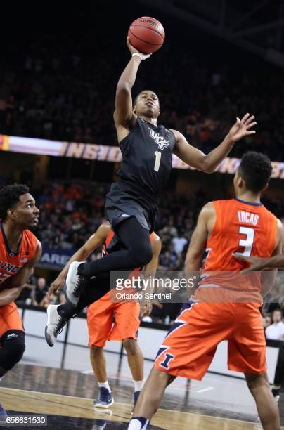 Central Florida's BJ Taylor scores in the lane against Illinois during an NIT Tournament quarterfinal at CFE Arena in Orlando Fla on Wednesday March...