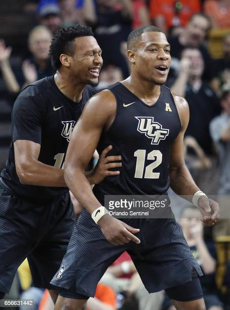 Central Florida's Nick Banyard and Matt Williams celebrate during an NIT Tournament quarterfinals against Illinois at CFE Arena in Orlando Fla on...