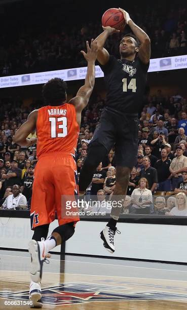Central Florida's Nick Banyard shoots over Illinois guard Tracy Abrams during an NIT Tournament quarterfinal at CFE Arena in Orlando Fla on Wednesday...