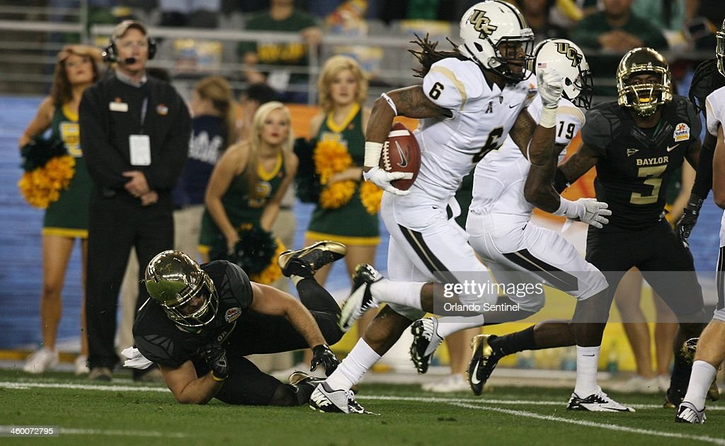 Central Florida's Rannell Hall runs during a 50yard touchdown reception in the second quarter against Baylor during the Tostitos Fiesta Bowl at...