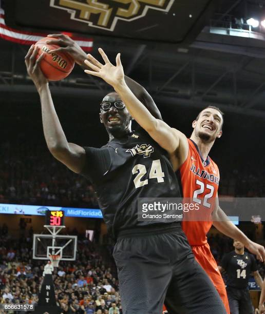 Central Florida's Tacko Fall grabs a rebound against Maverick Morgan of Illinois during an NIT Tournament quarterfinal at CFE Arena in Orlando Fla on...