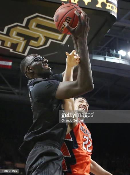 Central Florida's Tacko Fall scores over Maverick Morgan of Illinois during an NIT Tournament quarterfinal at CFE Arena in Orlando Fla on Wednesday...