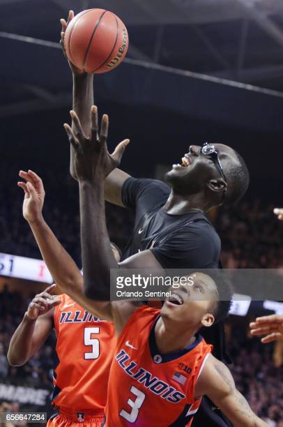 Central Florida's Tacko Fall top grabs the ball over Illinois guard Te'Jon Lucas during an NIT Tournament quarterfinal at CFE Arena in Orlando Fla on...