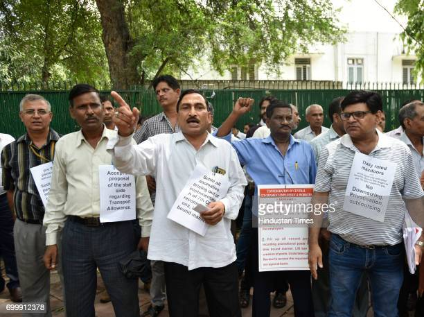Central government employees and workers raise slogans during a protest over downsizing privatisation outsourcing and other issues outside Nirman...