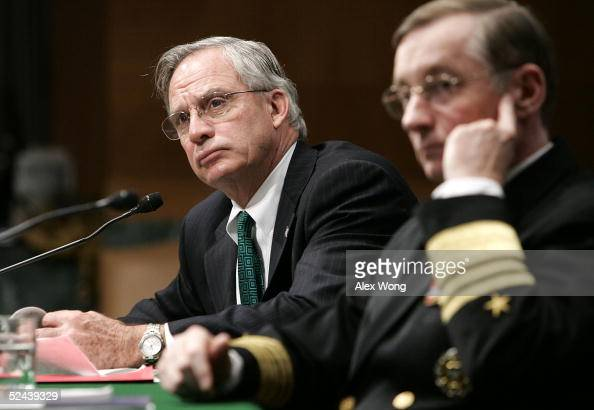 Central Intelligence Agency Director Porter Goss and Defense Intelligence Agency Director Lowell Jacoby listen to questions during a hearing before...