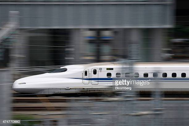 A Central Japan Railway Co N700 series Shinkansen bullet train approaches Tokyo Station in Tokyo Japan on Sunday May 24 2015 Japan was first in the...