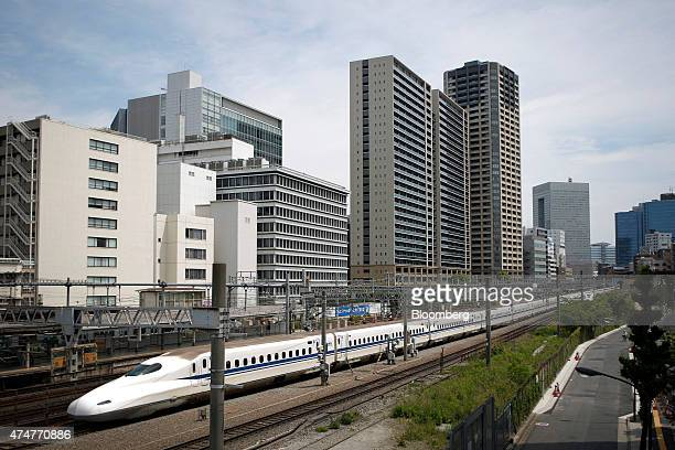 A Central Japan Railway Co N700 series Shinkansen bullet train travels along a railway track in Tokyo Japan on Sunday May 24 2015 Japan was first in...