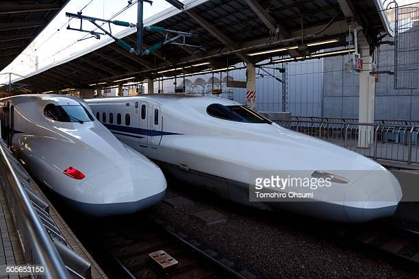 Central Japan Railway Co Shinkansen bullet trains stand on the platform at Tokyo Station on January 19 2016 in Tokyo Japan Japanese rollingstock...
