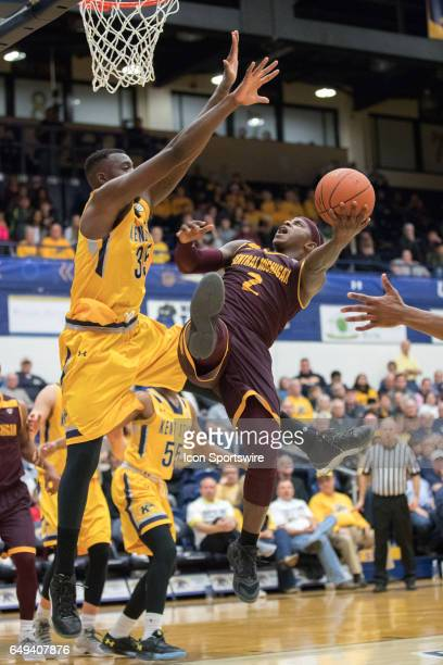 Central Michigan Chippewas G Braylon Rayson shoots as Kent State Golden Flashes F Jimmy Hall defends during the first half of the MAC men's...