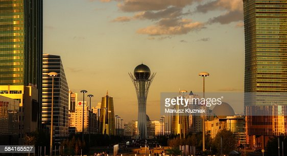 Central modern Astana and Bayterek Tower sunset