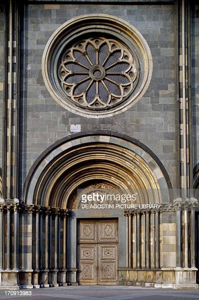 Central portal and rose window detail from the facade of the Basilica di Sant'Andrea Vercelli Piedmont Italy