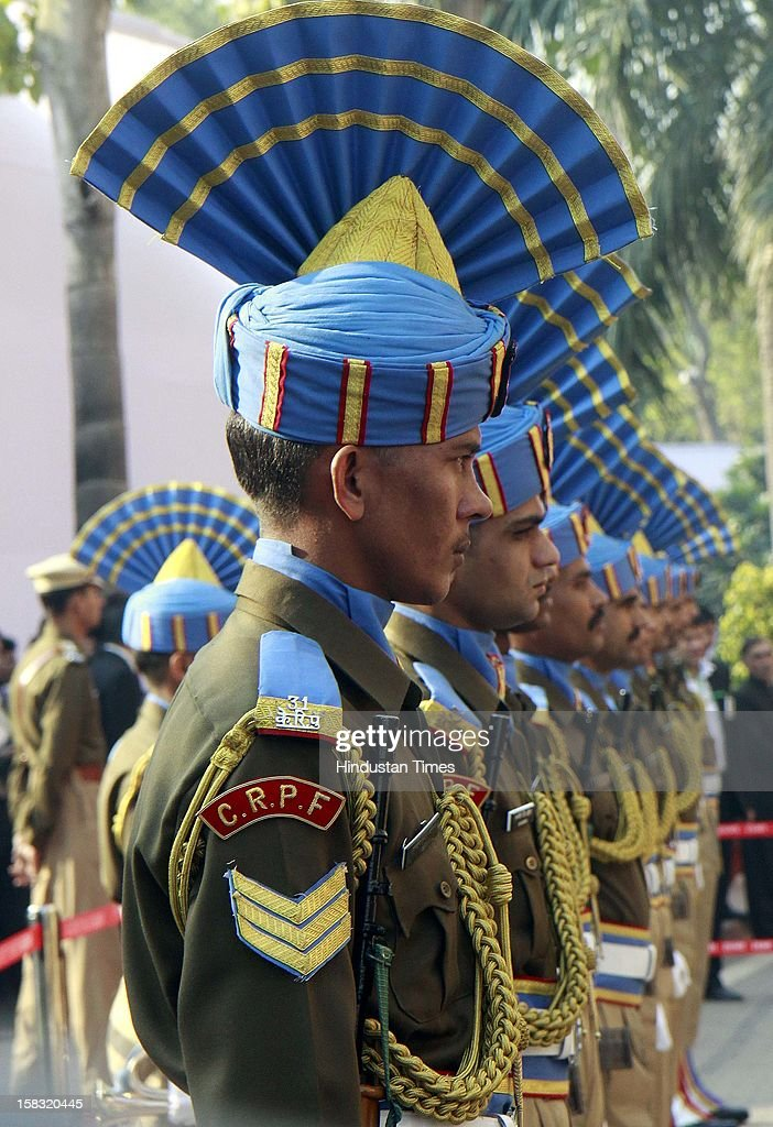 Central Reserve Police Force (CRPF) personnel pay homage to martyrs during a remembrance ceremony of the 2001 Parliament attack, at Parliament House on December 13, 2012 in New Delhi, India. Politicans gathered to observe the eleventh anniversary of a bloody militant attack on the complex, which left 14 dead on December 13, 2001.