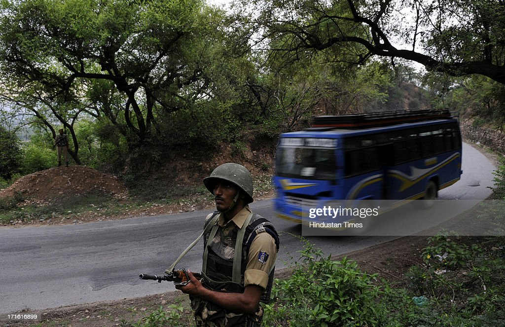 A central Reserve Police Force soldier patrol the Jammu- Srinagar highway as the first batch of Amarnath pilgrims began their journey on June 27, 2013 in Jammu, India. Hundreds of thousands of pilgrims flock each year to the Amarnath shrine which contains a large icicle revered by Hindus as an incarnation of Lord Shiva, the Hindu god of destruction and regeneration.