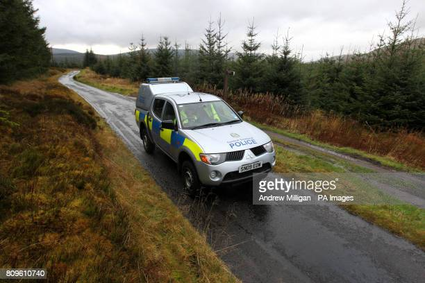 Central Scotland Police officers in a police car at a road block on a country road in the vicinity of Carron Valley Reservoir near Fintry...
