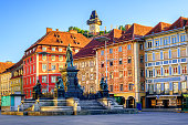 Painted facades and the Clocktower in the old town of Graz, Austria are on UNESCO World Cultural Heritage list
