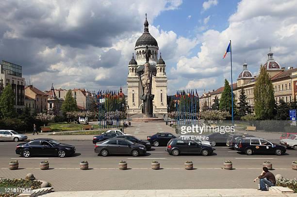 Central square with orthodox church and statue, Cluj Napoca, Romania