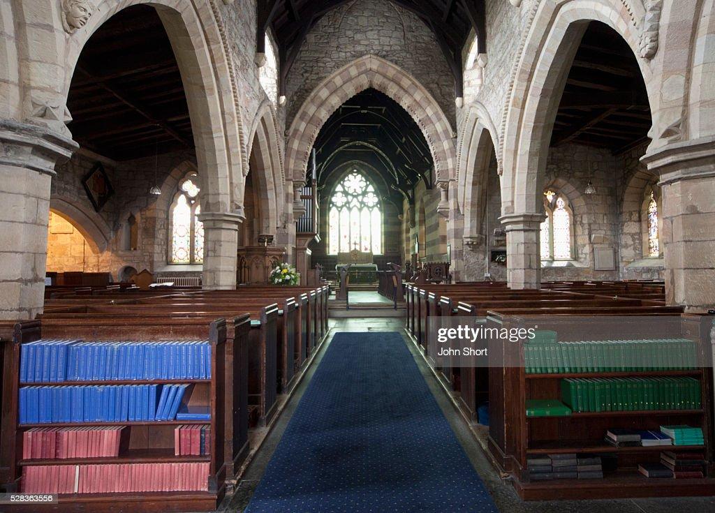 Centre Aisle And Shelves Of Hymn Books Inside A Church; Northumberland England