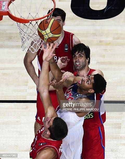 US centre Anthony Davis vies with Serbia's guard Milos Teodosic during the 2014 FIBA World basketball championships final match USA vs Serbia at the...