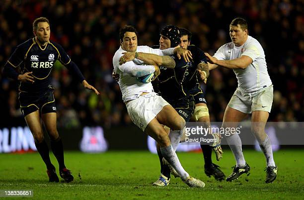 Centre Brad Barritt of England is tackled by Alasdair Strokosch of Scotland during the RBS Six Nations match between Scotland and England at...