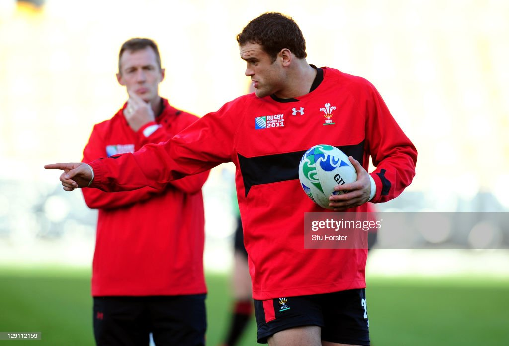Centre Jamie Roberts (R) speaks with Wales assistant coach Rob Howley (L) during a Wales IRB Rugby World Cup 2011 training session at Mt Smart Stadium on October 13, 2011 in Auckland, New Zealand.