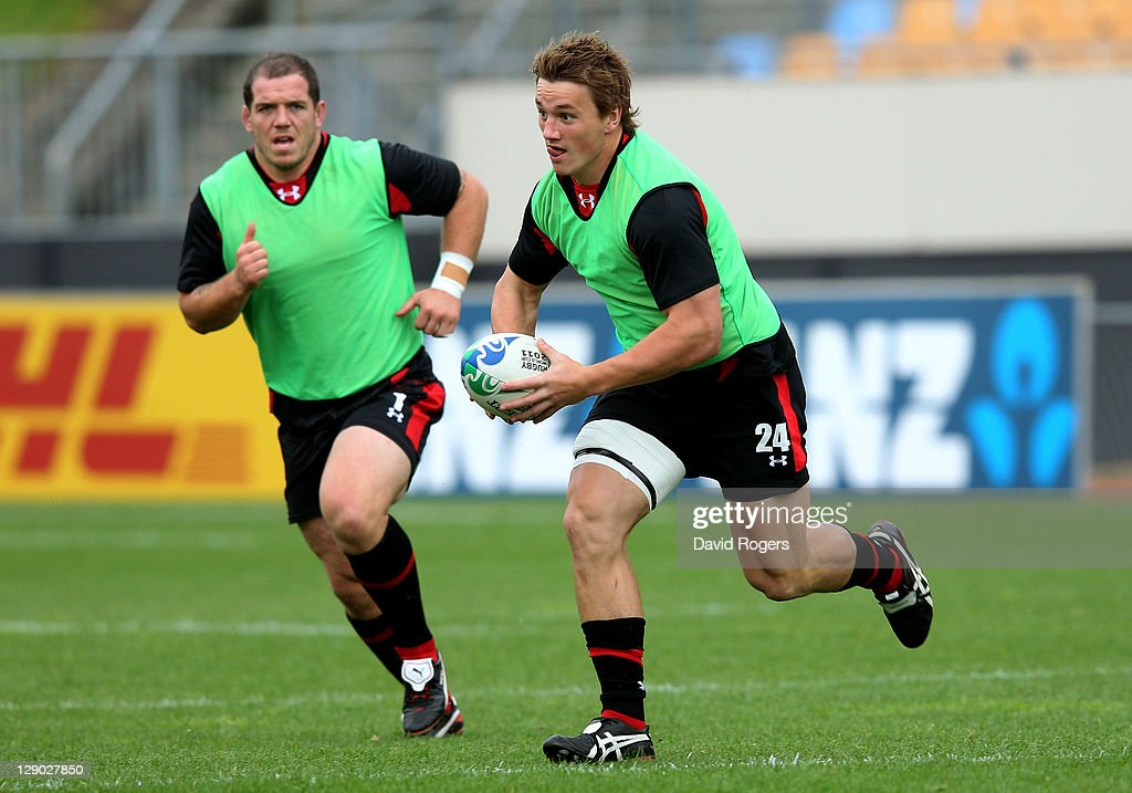 Centre Jonathan Davies is pursued by prop Paul James during a Wales IRB Rugby World Cup 2011 training session at Mt Smart Stadium on October 11, 2011 in Auckland, New Zealand.